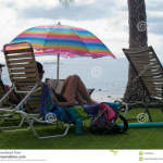 http://www.dreamstime.com/royalty-free-stock-image-couple-relaxing-under-colorful-umbrella-reading-book-image47029816
